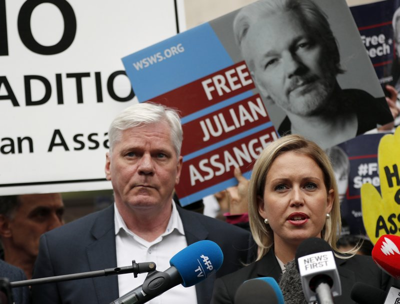 Kristinn Hrafnsson, Editor-in-chief of WikiLeaks and barrister Jennifer Robinson, right, address the media outside Westminster Magistrate Court in London, Thursday, May 2, 2019. WikiLeaks founder Julian Assange, seen in poster behind, is facing court over a U.S. request to extradite him for alleged computer hacking. (AP Photo/Frank Augstein)