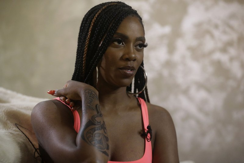 In this photo taken on Thursday, May 2, 2019, Nigerian singer-songwriter Tiwa Savage talks, during an interview with The Associated Press in Lagos, Nigeria. Savage says there's a