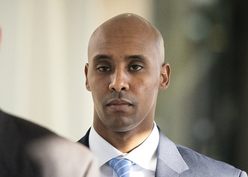 FILE - In this Friday, April 26, 2019, file photo, former Minneapolis police officer Mohamed Noor walks to court in Minneapolis. The city of Minneapolis is paying $20 million to settle a lawsuit over Noor's fatal shooting of the unarmed Justine Ruszczyk Damond, who approached his squad car after calling 911 to report a possible crime. Mayor Jacob Frey announced the settlement Friday, three days after a jury convicted Noor of murder and manslaughter in the 2017 death of Damond. Frey called the settlement