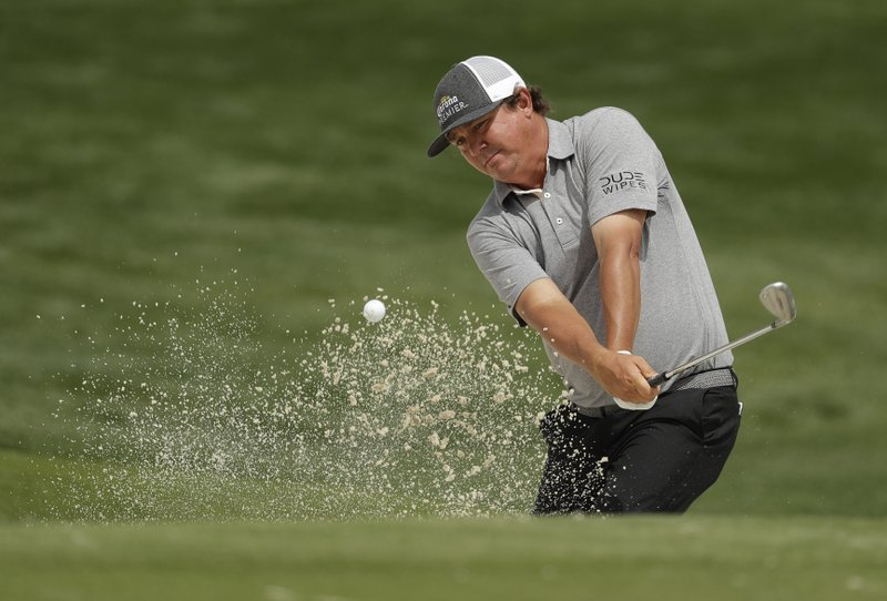Jason Dufner hits from a sand trap on the 16th hole during the second round of the Wells Fargo Championship golf tournament at Quail Hollow Club in Charlotte, N.C., Friday, May 3, 2019. (AP Photo/Chuck Burton)