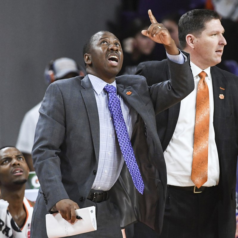 In this February, 2019 photo, Clemson assistant coach Steve Smith, left, gestures alongside head coach Brad Brownell during an NCAA college basketball game in Clemson, S.C. Clemson has parted ways Smith on Friday, May 3, 2019, after his voice was heard on a federal wiretap involving defendant Christian Dawkins on the ongoing trial into college corruption. (Ken Ruinard/The Independent-Mail via AP)