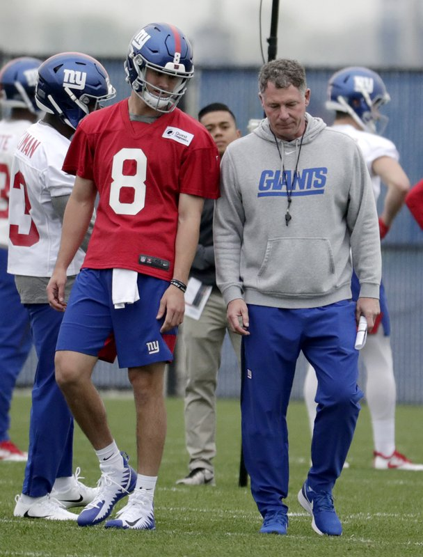 New York Giants quarterback Daniel Jones (8), who was drafted No. 6 overall, talks to head coach Pat Shurmur during NFL football rookie camp, Friday, May 3, 2019, in East Rutherford, N.J. (AP Photo/Julio Cortez)