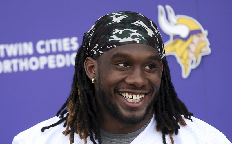 Minnesota Vikings rookie running back Alexander Mattison enjoys a laugh with reporters after the first day of workouts for rookies at the NFL football team's complex Friday, May 3, 2019, in Eagan, Minn. Mattison, drafted in the third round, played college football at Boise State. (AP Photo/Jim Mone)