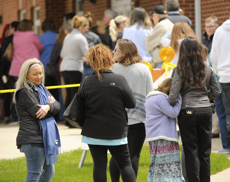 Michelle Cairo of Crystal Lake, left, waits in line with other mourners to attend the visitation of 5 year old A.J. Freund of Crystal Lake at Davenport Family Funeral Home on Friday, May 3, 2019 in Crystal Lake, Ill. (Mark Black/Chicago Sun-Times via AP)