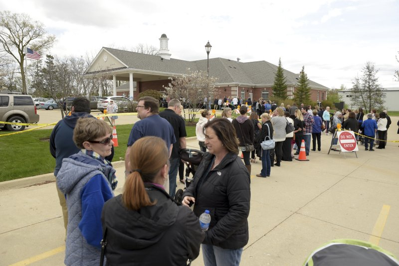 Mourners line up to attend the visitation of 5 year old A.J. Freund of Crystal Lake at Davenport Family Funeral Home on Friday, May 3, 2019 in Crystal Lake, Ill. (Mark Black/Chicago Sun-Times via AP)