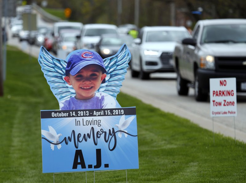 Cars line up along Terra Cotta Avenue Friday, May 3, 2019, as mourners head to visitation services for AJ Freund at Davenport Funeral Home in Crystal Lake, Ill. AJ'S parents, Andrew Freund Sr., 60, and JoAnn Cunningham, 36, were charged with his murder. (Brian Hill/The Daily Herald via AP)