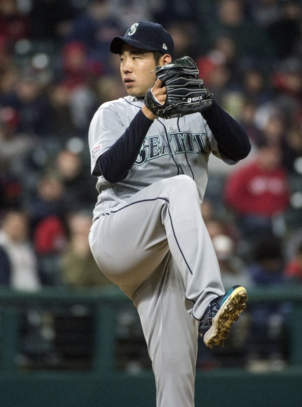 Seattle Mariners starting pitcher Yusei Kikuchi delivers to Cleveland Indians' Carlos Gonzalez during the seventh inning of a baseball game in Cleveland, Friday, May 3, 2019. (AP Photo/Phil Long)