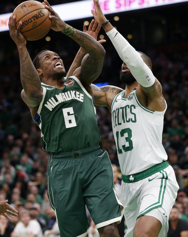 Milwaukee Bucks' Eric Bledsoe (6) shoots against Boston Celtics' Marcus Morris (13) during the first half of Game 3 of a second round NBA basketball playoff series in Boston, Friday, May 3, 2019. (AP Photo/Michael Dwyer)