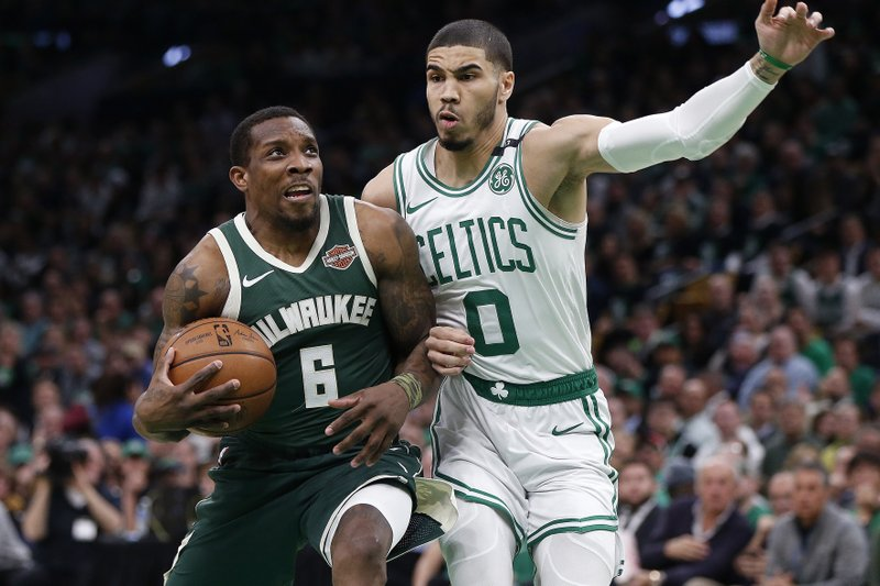 Milwaukee Bucks' Eric Bledsoe (6) drives as Boston Celtics' Jayson Tatum (0) defends during the first half of Game 3 of a second round NBA basketball playoff series in Boston, Friday, May 3, 2019. (AP Photo/Michael Dwyer)