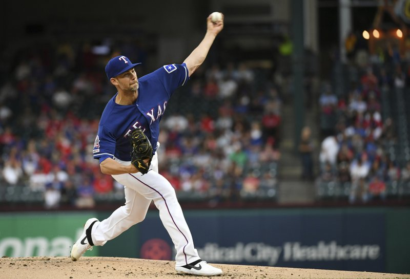 Texas Rangers starting pitcher Mike Minor works against the Toronto Blue Jays during the first inning of a baseball game Friday, May 3, 2019, in Arlington, Texas. (AP Photo/Jeffrey McWhorter)