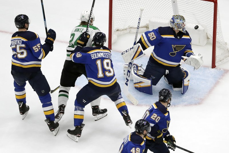 Dallas Stars right wing Roope Hintz (24), of Finland, watches as a shot by teammate Esa Lindell, not shown, gets past St. Louis Blues goaltender Jordan Binnington (50) for a goal during the second period in Game 5 of an NHL second-round hockey playoff series Friday, May 3, 2019, in St. Louis. Also defending for the Blues are Colton Parayko (55) and Jay Bouwmeester (19). (AP Photo/Jeff Roberson)