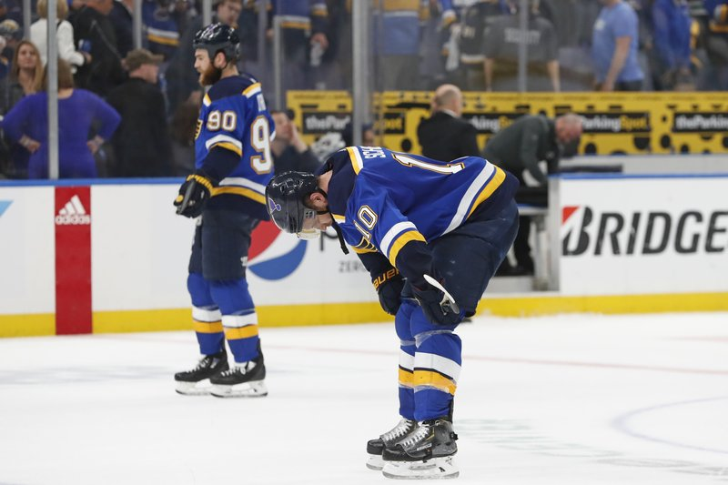 St. Louis Blues' Brayden Schenn (10) and Ryan O'Reilly (90) skate to the bench after losing to the Dallas Stars in Game 5 of an NHL second-round hockey playoff series Friday, May 3, 2019, in St. Louis. The Stars won 2-1 and lead the series 3-2. (AP Photo/Jeff Roberson)