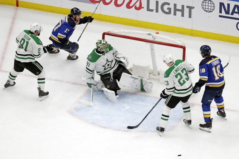 St. Louis Blues left wing Jaden Schwartz (17) skates behind Dallas Stars goaltender Ben Bishop (30) after scoring a goal during the third period in Game 5 of an NHL second-round hockey playoff series Friday, May 3, 2019, in St. Louis. (AP Photo/Jeff Roberson)