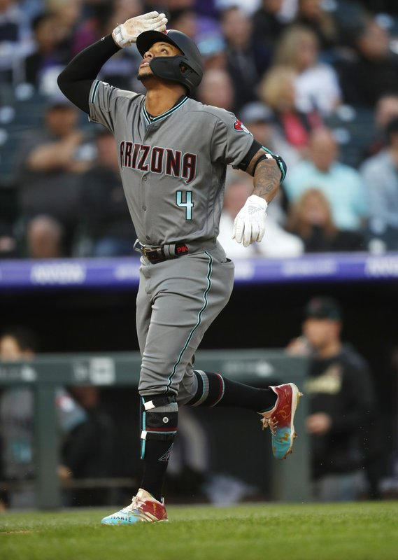 Arizona Diamondbacks' Ketel Marte gestures as he circles the bases after hitting a two-run home run off Colorado Rockies starting pitcher Tyler Anderson in the third inning of a baseball game Friday, May 3, 2019, in Denver. (AP Photo/David Zalubowski)