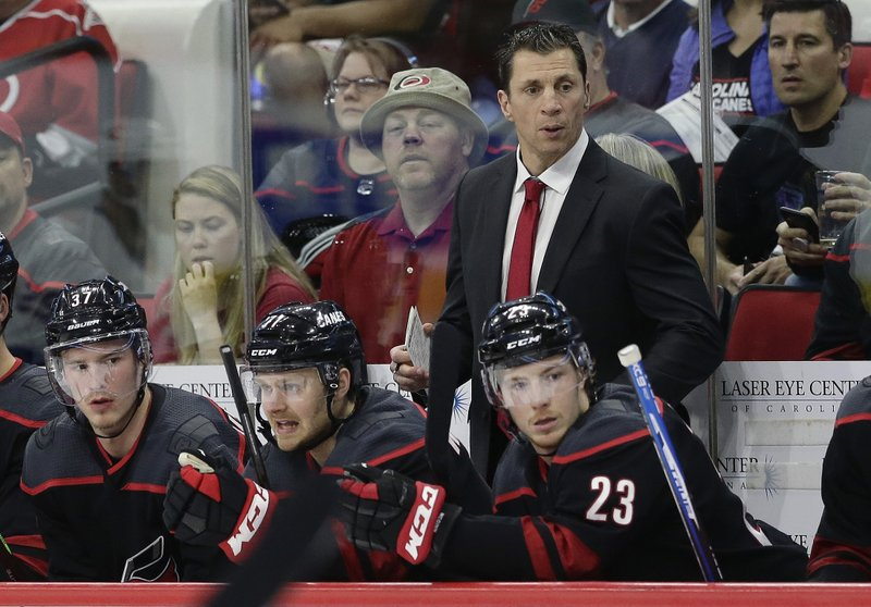 Carolina Hurricanes coach Rod Brind'Amour watches during the first period of Game 4 of an NHL hockey second-round playoff series against the New York Islanders in Raleigh, N.C., Friday, May 3, 2019. (AP Photo/Gerry Broome)