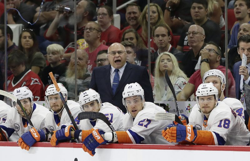 New York Islanders coach Barry Trotz yells during the first period of Game 4 of an NHL hockey second-round playoff series against the Carolina Hurricanes in Raleigh, N.C., Friday, May 3, 2019. (AP Photo/Gerry Broome)