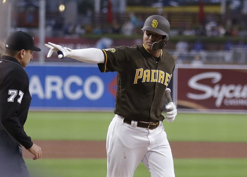 San Diego Padres' Manny Machado gestures as he rounds the bases after hitting a two-run home run during the first inning of a baseball game against the Los Angeles Dodgers on Friday, May 3, 2019, in San Diego. (AP Photo/Gregory Bull)