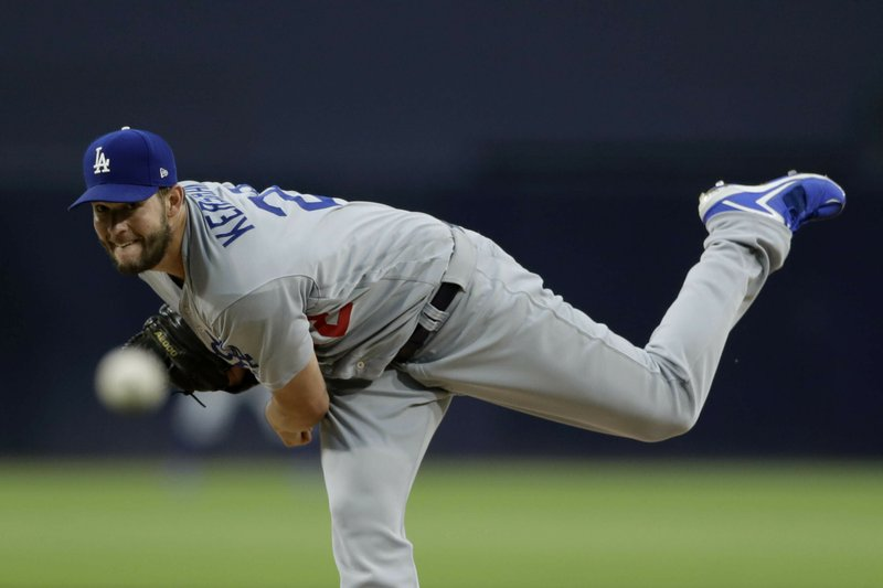 Los Angeles Dodgers starting pitcher Clayton Kershaw works against a San Diego Padres batter during the first inning of a baseball game Friday, May 3, 2019, in San Diego. (AP Photo/Gregory Bull)
