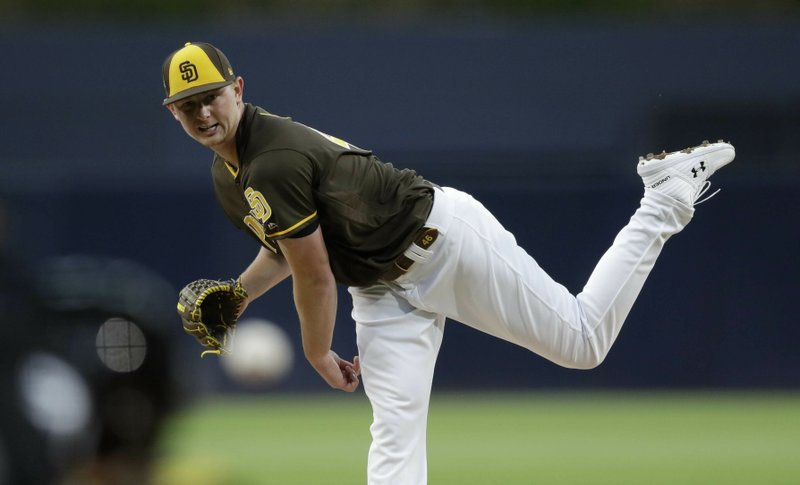 San Diego Padres starting pitcher Eric Lauer works against a Los Angeles Dodgers batter during the first inning of a baseball game Friday, May 3, 2019, in San Diego. (AP Photo/Gregory Bull)