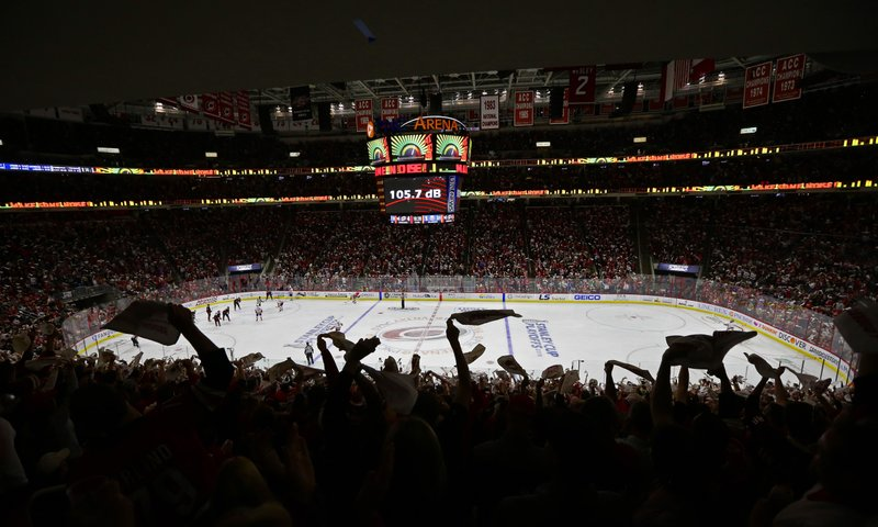 Fans cheers during the third period of Game 4 of an NHL hockey second-round playoff series between the Carolina Hurricanes and the New York Islanders in Raleigh, N.C., Friday, May 3, 2019. (AP Photo/Gerry Broome)
