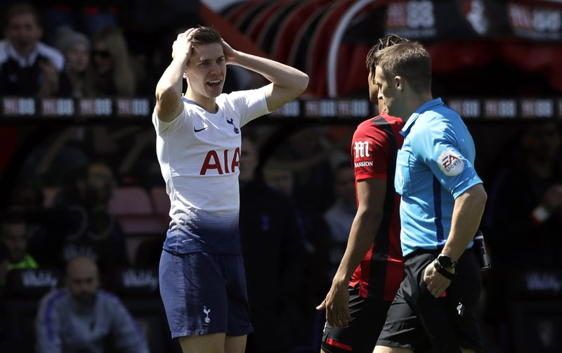 Tottenham's Juan Foyth, reacts after Referee Craig Pawson showed him a red card during the English Premier League soccer match between AFC Bournemouth and Tottenham Hotspur at the Vitality Stadium in Bournemouth, England, Saturday May 4, 2019. (AP Photo/Matt Dunham)