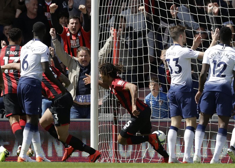 Bournemouth's Nathan Ake, center, celebrates after scoring the opening goal during the English Premier League soccer match between AFC Bournemouth and Tottenham Hotspur at the Vitality Stadium in Bournemouth, England, Saturday May 4, 2019. (AP Photo/Matt Dunham)