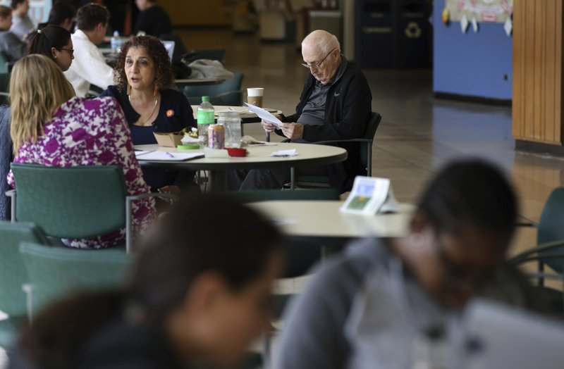 Student Bob Dwyer, 90, studies his notes for a final exam in the common area during a break at Northeastern Illinois University, Wednesday, April 24, 2019. Dwyer will make history Monday when he graduates from Northeastern Illinois University, becoming the school's oldest student to receive his bachelor's degree since the school started keeping such records in 1962. (Antonio Perez/Chicago Tribune via AP)