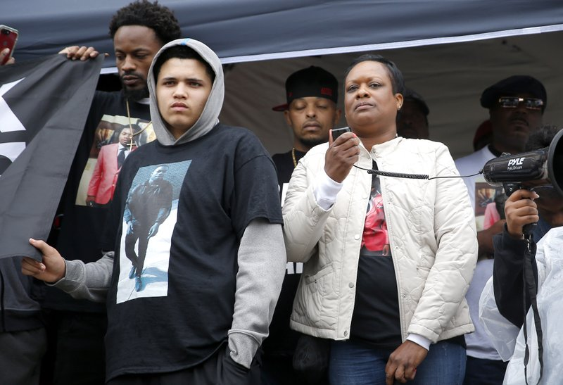 Vicki Lewis, mother of Isaiah Lewis, speaks to the crowd during a Black Lives Matter protest rally on the steps of the Edmond Police Department in Edmond, Okla., Friday, May 3, 2019. Police in the Oklahoma City suburb of Edmond said that Isaiah Lewis, a naked 17-year-old high school student was not armed when he was fatally shot by police after breaking into a home.(Sarah Phipps/The Oklahoman via AP)