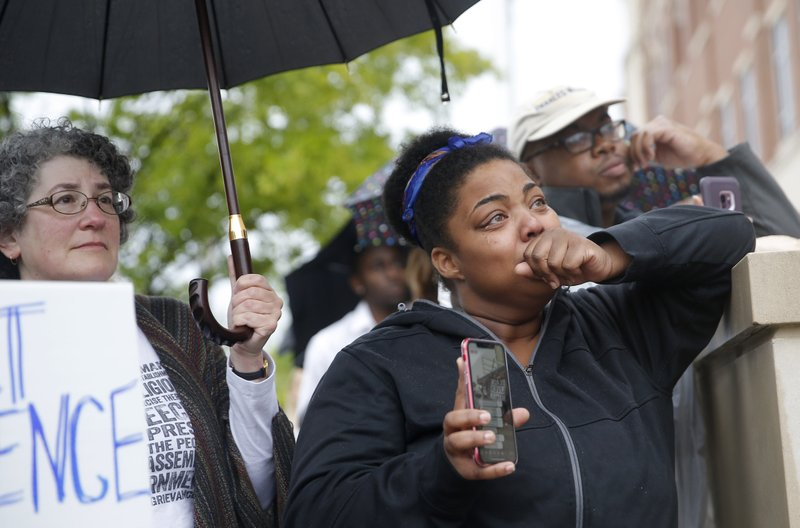People listen to speakers at the Edmond Police Department during a Black Lives Matter protest rally honoring the Life of Isaiah Lewis in Edmond, Okla., Friday, May 3, 2019. Police in the Oklahoma City suburb of Edmond said that Isaiah Lewis, a naked 17-year-old high school student was not armed when he was fatally shot by police after breaking into a home.(Sarah Phipps/The Oklahoman via AP)