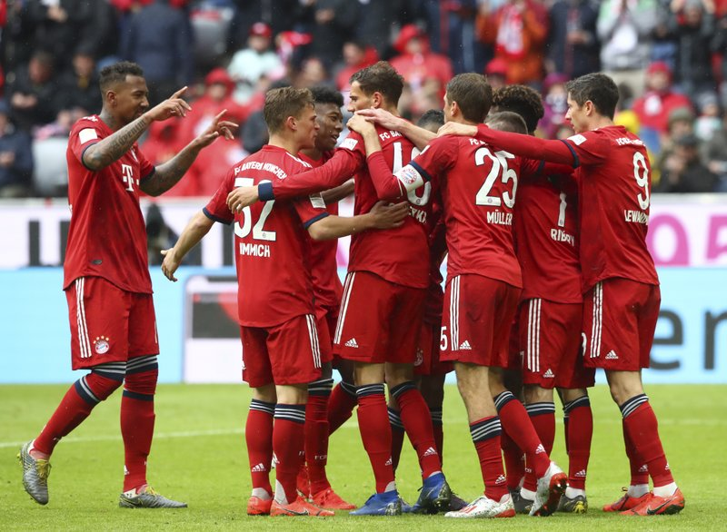Bayern's players celebrate after scoring their side's third goal during the German Bundesliga soccer match between FC Bayern Munich and Hannover 96 in Munich, Germany, Saturday, May 4, 2019. (AP Photo/Matthias Schrader)