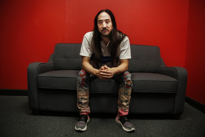 Steve Aoki sits for a portrait during a comic book signing of his new comic book series