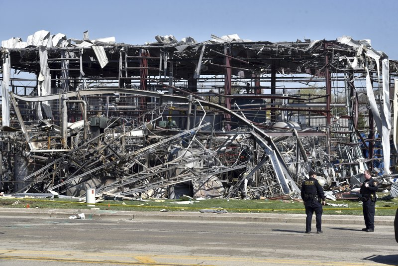 Emergency personnel work at the scene of an explosion at AB Specialty Silicones on Sunset Ave. and Northwestern Ave. on the border between Gurnee, Ill., and Waukegan on Saturday, May 4, 2019. The explosion happened Friday night. (John Starks/Daily Herald via AP)