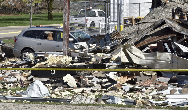 Vehicles are covered by rubble at the scene of an explosion at AB Specialty Silicones on Sunset Ave. and Northwestern Ave. on the border between Gurnee, Ill., and Waukegan. The explosion happened Friday night. (John Starks/Daily Herald via AP)