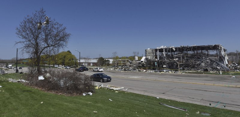 Debris is stuck in trees across the street at the scene of an explosion at AB Specialty Silicones on Sunset Ave. and Northwestern Ave. on the border between Gurnee, Ill., and Waukegan on Saturday, May 4, 2019. The explosion happened Friday night. (John Starks/Daily Herald via AP)