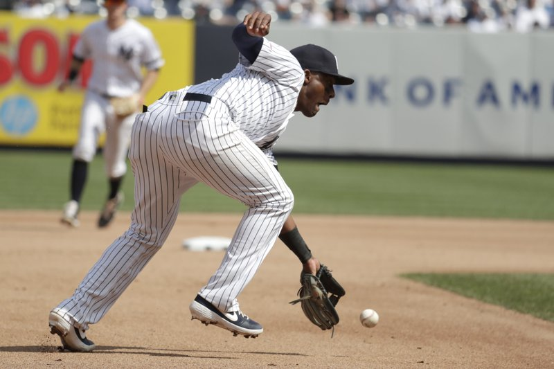 New York Yankees third baseman Miguel Andujar fields a ground ball hit by Minnesota Twins' Nelson Cruz during the seventh inning of a baseball game, Saturday, May 4, 2019, in New York. Andujar overthrew second base while trying to conduct a double play and Twins' Mitch Garver was able to move to third base on the error. (AP Photo/Julio Cortez)