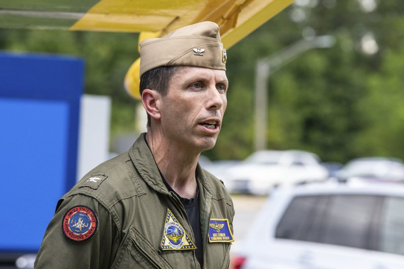 Base Commander Captain Mike Connor, Commanding Officer NAS Jacksonville, speaks about Friday's plane crash at a news conference at the front gate of the Naval Air Station in Jacksonville, Fla., Saturday afternoon, May 4, 2019. A charter plane with multiple passengers traveling from Cuba to north Florida ended up in a river at the end of a runway Friday night, though no critical injuries or deaths were reported, officials said. (AP Photo/Gary McCullough)
