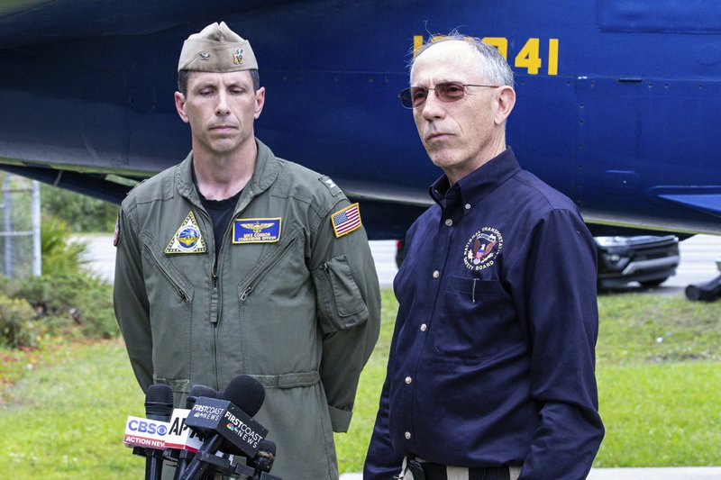 Base Commander Captain Mike Connor, Commanding Officer NAS Jacksonville, and NTSB Vice Chairman Bruce Landsberg, right, speak about Friday's plane crash at a news conference at the front gate of the Naval Air Station in Jacksonville, Fla., Saturday afternoon, May 4, 2019. A charter plane with multiple passengers traveling from Cuba to north Florida ended up in a river at the end of a runway Friday night, though no critical injuries or deaths were reported, officials said. (AP Photo/Gary McCullough)