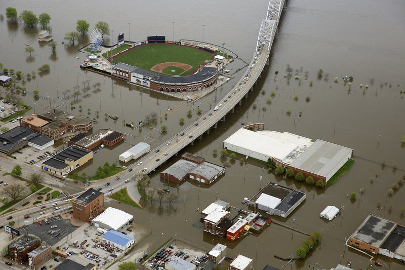 An aerial photo of Davenport, Iowa, shows Modern Woodmen Park, top, and the surrounding area covered by Mississippi River floodwaters, Friday, May 3, 2019. Iowa Gov. Kim Reynolds visited Davenport Friday. Several blocks of downtown Davenport were flooded this week when a flood barrier succumbed to the onslaught of water. (Kevin E. Schmidt/Quad City Times via AP)