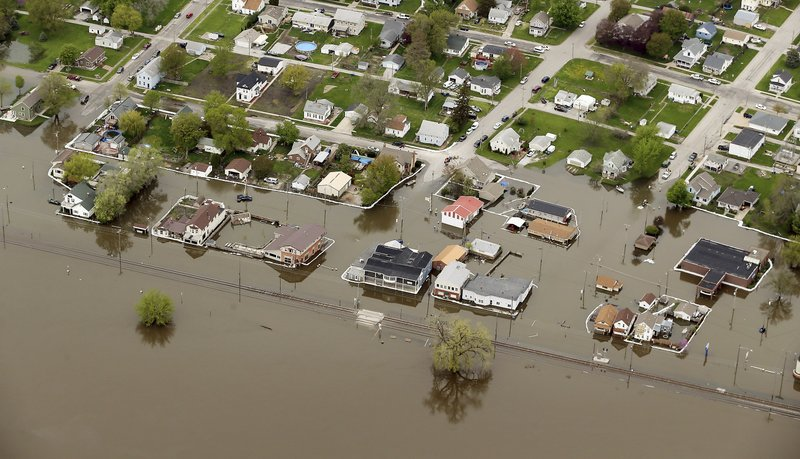 An aerial photo shows the Mississippi River flooding in Buffalo, Iowa, Friday, May 3, 2019. The National Weather Service issued flood warnings Friday along a large swath of the Mississippi River. (Kevin E. Schmidt/Quad City Times via AP)