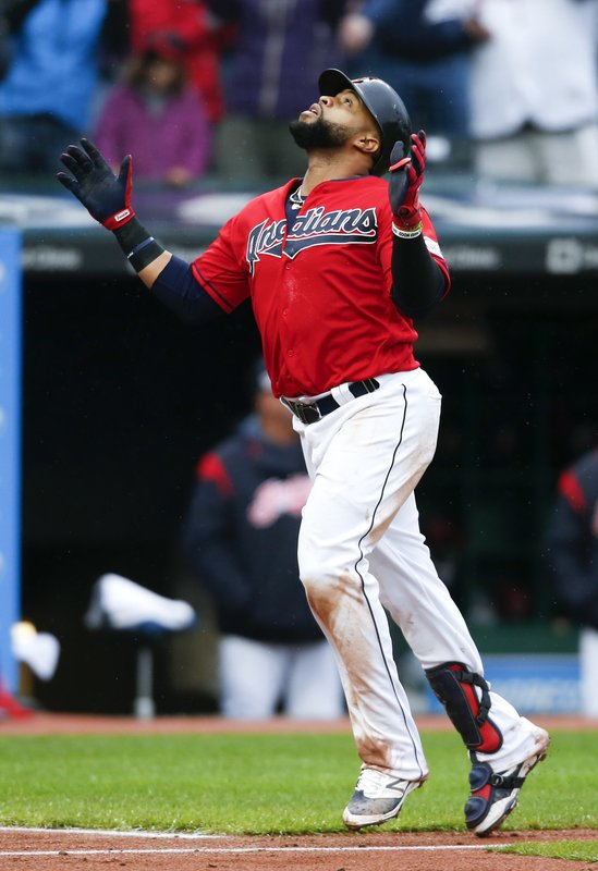Cleveland Indians' Carlos Santana celebrates after hitting a two-run home run off Seattle Mariners relief pitcher Connor Sadzeck during the eighth inning of a baseball game, Saturday, May 4, 2019, in Cleveland. The Indians defeated the Mariners 5-4. (AP Photo/Ron Schwane)