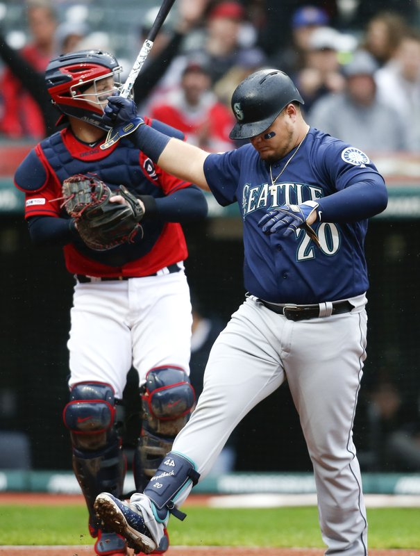 Seattle Mariners' Daniel Vogelbach (20) reacts after striking out against Cleveland Indians starting pitcher Carlos Carrasco during the sixth inning of a baseball game, Saturday, May 4, 2019, in Cleveland. The Indians defeated the Mariners 5-4. (AP Photo/Ron Schwane)