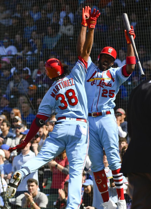 St. Louis Cardinals' Jose Martinez (38) high-fives Dexter Fowler (25) after Martinez hit a home run during the second inning of a baseball game against the Chicago Cubs, Saturday, May 4, 2019, in Chicago. (AP Photo/Matt Marton)