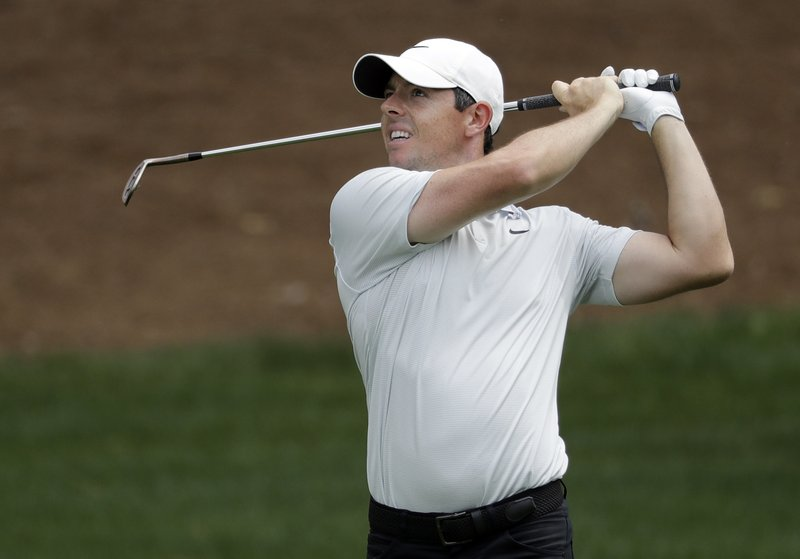 Rory McIlroy, of Northern Ireland, watches his approach shot on the second hole during the third round of the Wells Fargo Championship golf tournament at Quail Hollow Club in Charlotte, N.C., Saturday, May 4, 2019. (AP Photo/Chuck Burton)