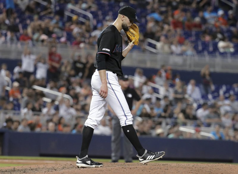 Miami Marlins relief pitcher Nick Anderson stands on the mound after giving up a grand slam to Atlanta Braves' Ozzie Albies during the sixth inning of a baseball game Saturday, May 4, 2019, in Miami. (AP Photo/Lynne Sladky)