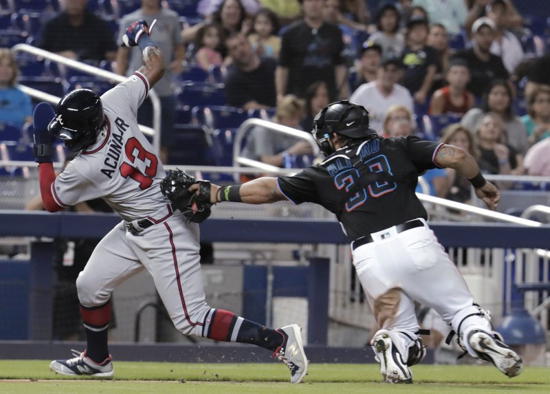 Atlanta Braves' Ronald Acuna Jr. (13) is tagged out in a rundown by Miami Marlins catcher Jorge Alfaro (38) during the sixth inning of a baseball game Saturday, May 4, 2019, in Miami. (AP Photo/Lynne Sladky)