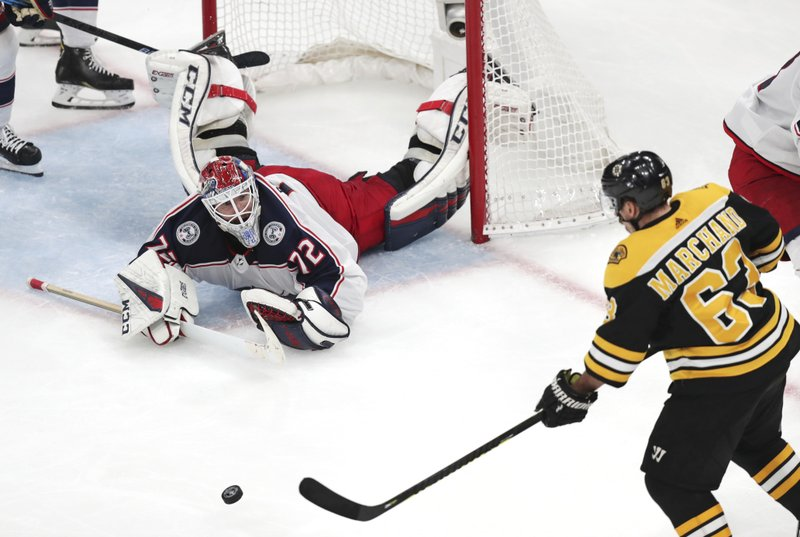 Columbus Blue Jackets goaltender Sergei Bobrovsky (72) drops to the ice after a save as Boston Bruins left wing Brad Marchand (63) lines up his goal during the third period of Game 5 of an NHL hockey second-round playoff series, Saturday, May 4, 2019, in Boston. (AP Photo/Charles Krupa)