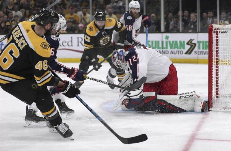 Boston Bruins' David Krejci (46), of the Czech Republic, scores a goal against Columbus Blue Jackets goaltender Sergei Bobrovsky (72), of Russia, during the second period in Game 5 of an NHL hockey second-round playoff series, Saturday, May 4, 2019, in Boston. (AP Photo/Charles Krupa)