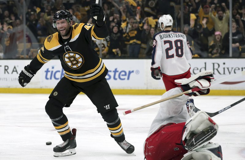 Boston Bruins' David Backes, left, celebrates a goal by teammate David Krejci past Columbus Blue Jackets goaltender Sergei Bobrovsky, of Russia, right, during the second period in Game 5 of an NHL hockey second-round playoff series, Saturday, May 4, 2019, in Boston. (AP Photo/Charles Krupa)