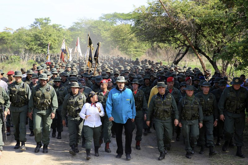 In this handout photo released by Miraflores Press Office, Venezuela's President Nicolas Maduro walks with troops at the G/J José Laurencio Silva training center in the state of Cojedes, Venezuela, Saturday, May 4, 2019. (Jhonn Zerpa/Miraflores Press Office via AP)