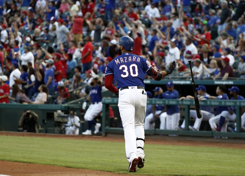 Texas Rangers' Nomar Mazara drops the bat as he runs toward first while watching his solo home run during the first inning of the team's baseball game against the Toronto Blue Jays in Arlington, Texas, Saturday, May 4, 2019. (AP Photo/Tony Gutierrez)